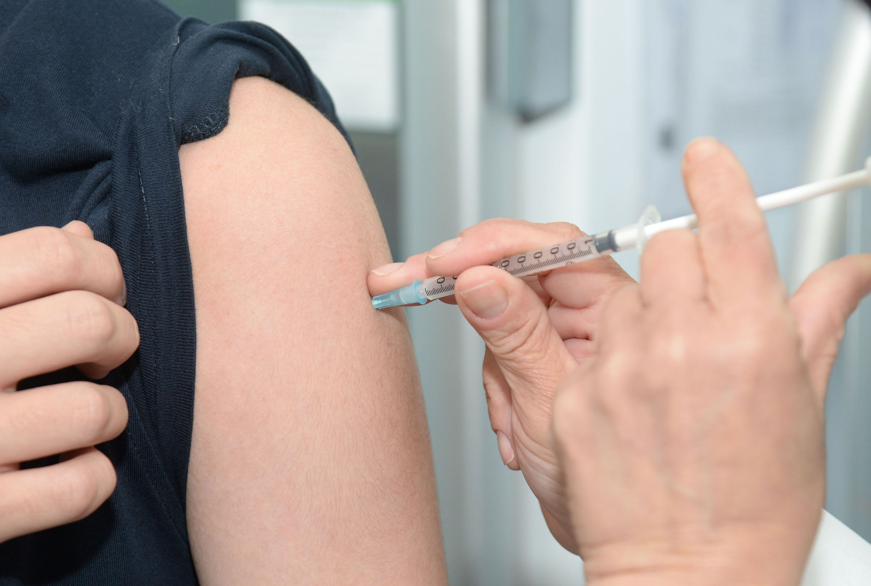 arm injection vaccination